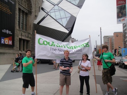 The Cookin' Greens  Team and some new  fans in front of the ROM